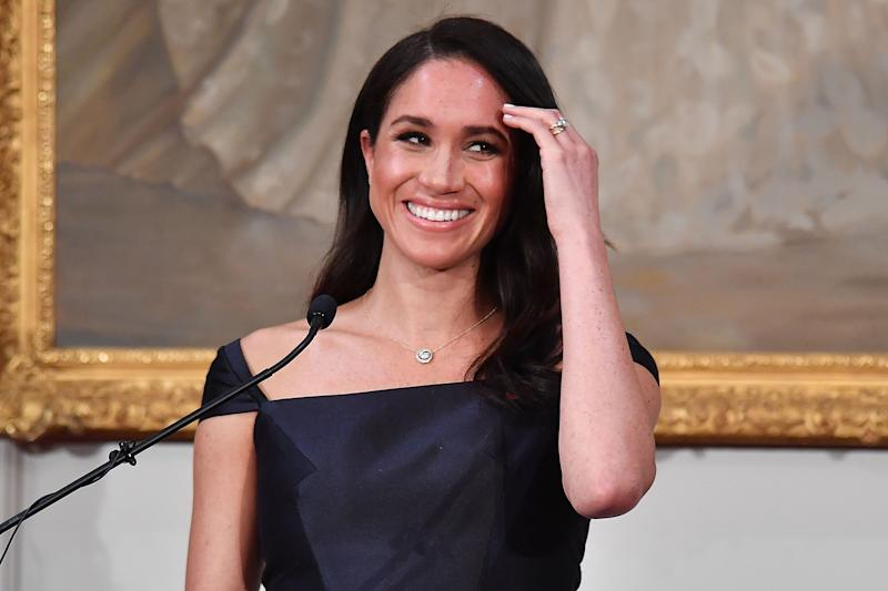 Britain's Meghan, Duchess of Sussex reacts as she speaks to invited guests during a reception at Government House in Wellington on October 28, 2018. - Prince Harry and Meghan arrived in Wellington on October 28 to a traditional Maori welcome, an official reception disrupted by a fire alarm and a rock star reception during a public walkabout. (Photo by Marty MELVILLE / POOL / AFP) (Photo credit should read MARTY MELVILLE/AFP via Getty Images)