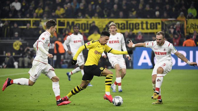 Performa Jadon Sancho terus meningkat pada musim 2019/20. Dalam 23 laganya bersama Dortmund, Sancho mampu mencatatkan 14 gol dan 15 assist. (AFP/Ina Fassbender)