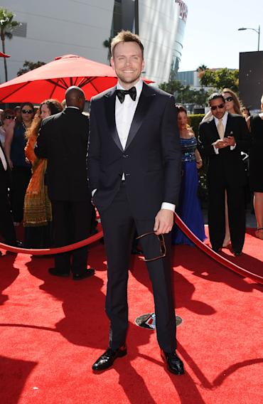 Joel McHale arrives at the 2013 Primetime Creative Arts Emmy Awards, on Sunday, September 15, 2013 at Nokia Theatre L.A. Live, in Los Angeles, Calif. (Photo by Scott Kirkland/Invision for Academy of Television Arts & Sciences/AP Images)