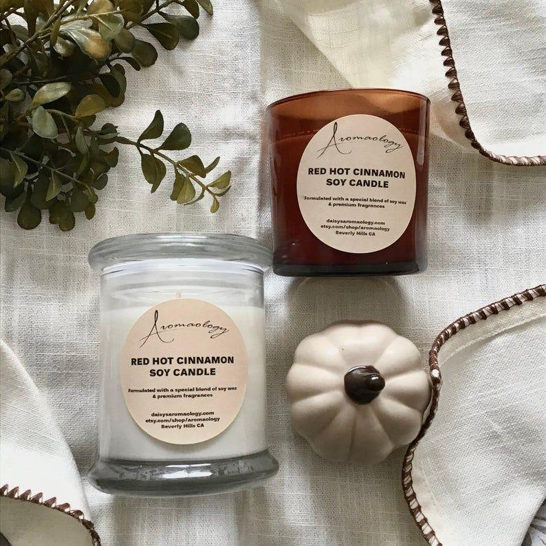 """<p><strong>Aromaology</strong></p><p>etsy.com</p><p><strong>$21.45</strong></p><p><a href=""""https://go.redirectingat.com?id=74968X1596630&url=https%3A%2F%2Fwww.etsy.com%2Flisting%2F478312992%2Fcinnamon-scented-candle-red-hot-cinnamon&sref=https%3A%2F%2Fwww.housebeautiful.com%2Fentertaining%2Fholidays-celebrations%2Fg34236289%2Fsecret-santa-gifts%2F"""" target=""""_blank"""">BUY NOW</a></p><p>When in doubt, a seasonal scented candle is always a good idea (especially when </p>"""