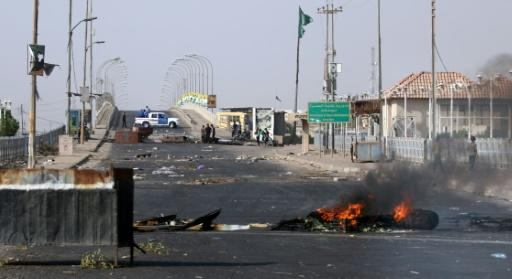 Demonstrators block a road and burn tyres in the southern Iraqi city of Basra on July 12, 2018 during an ongoing protest against unemployment and high cost of living