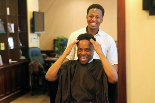 "This May 31, 2013 photo shows Tony Award nominee Billy Porter discussing his haircut with stylist Valjean Guerra at the men's spa BBraxton in the Harlem neighborhood of New York. Porter hopes to win his first Tony as best actor in a musical for his role as a drag queen in ""Kinky Boots."" (AP Photo/Mark Kennedy)"