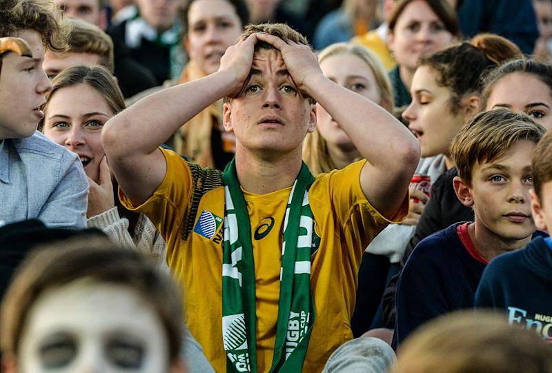 Australian fans look worried during the Rugby World Cup Final match between the New Zealand All Blacks and Australia Wallabies at Richmond Park Fan Zone on October 31, 2015 in London, United Kingdom.