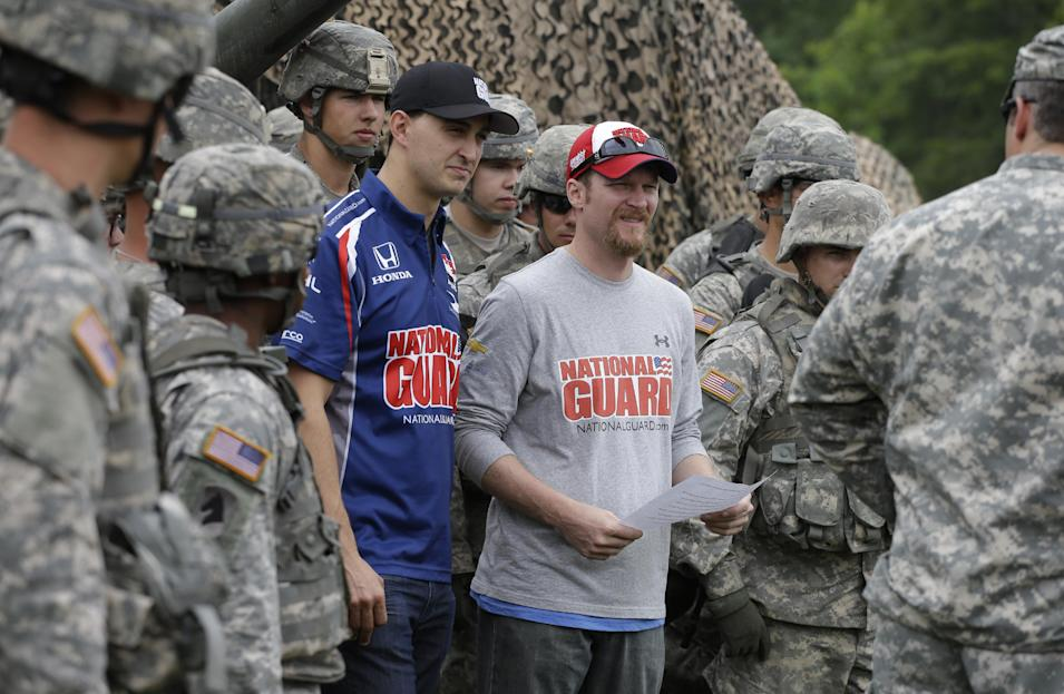 NASCAR driver Dale Earnhardt Jr., right, and IndyCar driver Graham Rahal talk to the soldiers at Camp Atterbury Wednesday, July 23, 2014, in Edinburgh, Ind. (AP Photo/Darron Cummings)