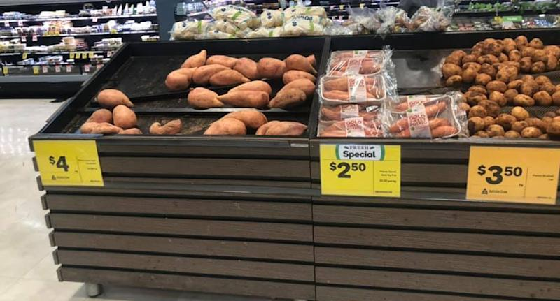 Sweet potatoes seen at a Woolworths in Tamworth. Potatoes packed in plastic have a price tag of $2.50. Unpacked ones have a $4 price tag. It's caused anger over claims plastic-wrapped potatoes are cheaper.