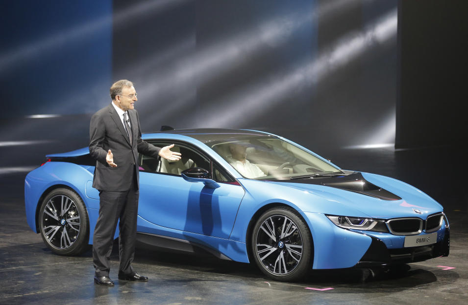 BMW CEO Norbert Reithofer presents the BMW i8 plug-in hybrid sports car during the first press day of the 65th Frankfurt Auto Show in Frankfurt, Germany, Tuesday, Sept. 10, 2013. More than 1,000 exhibitors will show their products to the public from Sept. 12 through Sept.22, 2013. (AP Photo/Frank Augstein)