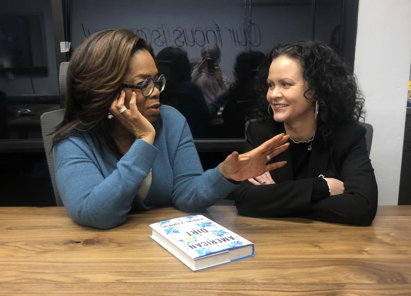 """In this Feb. 13, 2020 photo, Oprah Winfrey, left, and """"American Dirt"""" author Jeanine Cummins appear in a conference room just above Modern Studios in Tucson, Ariz., where they taped an Oprah's Book Club show about Cummins' controversial book. The two-part interview will begin streaming on Apple TV Plus at midnight ET on Friday, March 6. (AP Photo/Hillel Italie)"""