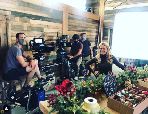 <p>Bure shared this photo with her Instagram followers in late August to give a preview of this upcoming Christmas movie. No news on what it'll be about yet, but you can expect all your favorite Hallmark Christmas themes.  </p>