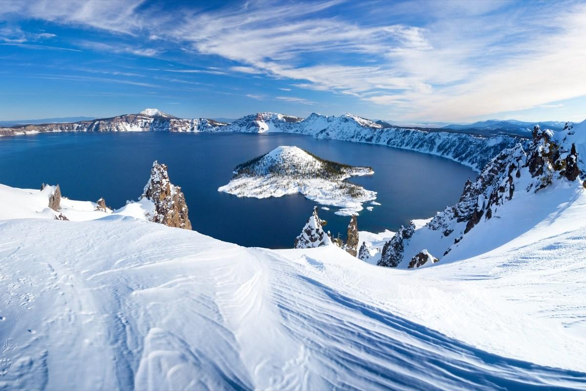"<strong>Where to fly</strong>: Rogue Valley International-Medford Airport (MFR)  Located in south-central Oregon, <a href=""https://www.nps.gov/crla/index.htm"" target=""_blank"">Crater Lake</a> is truly a spectacular sight to behold. Famous for its deep blue color and water clarity, tourists from all over the globe make the trek to this remote part of the Pacific Northwest to pay a visit to this <a href=""https://bestlifeonline.com/amazing-travel-destinations-in-the-us-youve-never-heard-of/?utm_source=yahoo-news&utm_medium=feed&utm_campaign=yahoo-feed"">national treasure</a>. With a depth of 1,949 feet, this lake is the deepest in the United States. But what makes it especially appealing is that visitors can actually swim in it, by following the <a href=""https://www.nps.gov/crla/planyourvisit/cleetwood-cove.htm"" target=""_blank"">Cleetwood Cove Trail</a>, which is slightly over a mile long and wraps around the lake, giving hikers impressive views of the surrounding lakeshore. Visitors to the lake can also fish, hike, camp, and go on boat tours during the lake's warmer seasons.  <strong>Pro tip</strong>: Nestled on the southwestern rim of Crater Lake is the <a href=""https://www.travelcraterlake.com/lodging-camping/crater-lake-lodge/"" target=""_blank"">Crater Lake Lodge</a>, built in 1915. More than a century later, the impeccable stone terrace and panoramic views of the lake make your stay incredible during any time of the year."