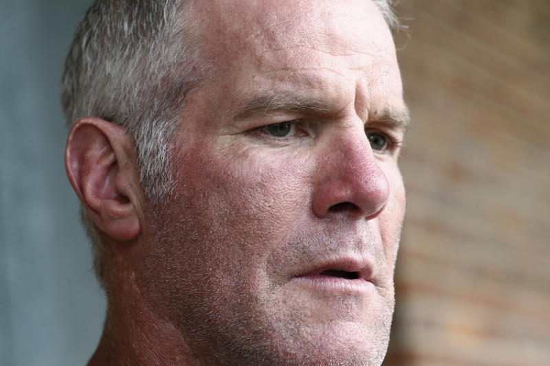 FILE - In this Oct. 17, 2018, file photo, former NFL quarterback Brett Favre speaks with reporters in Jackson, Miss., about his support for Willowood Developmental Center, a facility that provides training and assistance for special needs students, The Mississippi state auditor said Wednesday, May 6, 2020, that Favre is repaying $1.1 million he received for multiple speaking engagements where auditor's staffers said Favre did not show up. An audit of the Mississippi Department of Human Services, released May 4, said a nonprofit group used welfare money to pay Favre for $500,000 in December 2017 and $600,000 in June 2018. Favre is not charged with any wrongdoing. (AP Photo/Rogelio V. Solis, File)