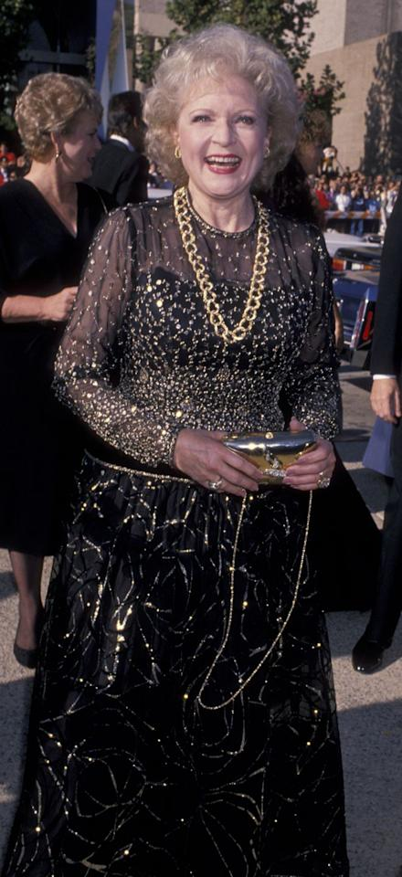 <p>Taking cues from Mr. T, the memorable Betty White donned an oversized, gold chain necklace with a black and gold sequined dress. </p>