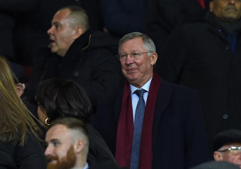 Manchester United's former manager Alex Ferguson looks on from the stands ahead of the FA Cup fourth round replay football match between Manchester United and Cambridge United at Old Trafford on February 3, 2015