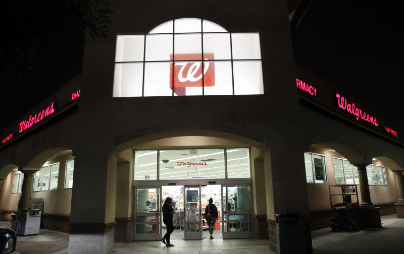 """FILE - In this June 24, 2019 file photo, shoppers enter a Walgreens store in Los Angeles. Pharmacy chains, including Walgreens, are fighting claims that they're to blame for the opioid crisis in two Ohio counties. The Monday, Jan. 6, 2020, filings asked U.S. district Court Judge Dan Polster to find in the pharmacies' favor and reject claims brought by Summit and Cuyahoga counties, home to Akron and Cleveland respectively, that argue that chains such as CVS, Rite Aid and Walgreens contributed to the problem by filling an """"excessive volume"""" of opioid prescriptions.  (AP Photo/Marcio Jose Sanchez, File)"""