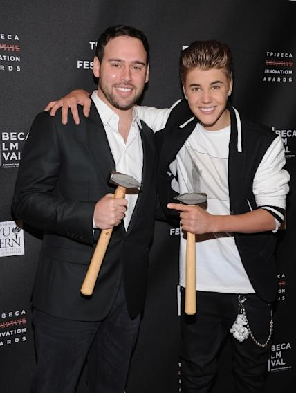Scooter Braun and Justin Bieber attend the 3rd annual Tribeca Disruptive Innovation Awards during the 2012 Tribeca Film Festival at NYU Paulson Auditorium, New York City, on April 27, 2012 -- WireImage