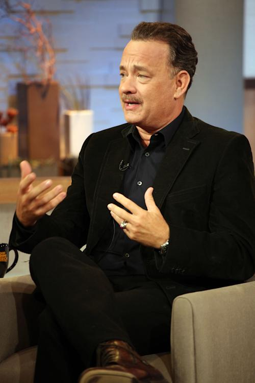 """This image released by ABC shows actor Tom Hanks during an interview segment on """"Good Morning America,"""" Friday, Oct. 19, 2012 in New York. ABC and Tom Hanks are apologizing after the actor let slip a swear word during a live appearance on """"Good Morning America."""" Hanks telegraphed his """"f-bomb"""" during an interview Friday. Anchor Elizabeth Vargas had asked him to speak in his character's British accent in the movie """"Cloud Atlas."""" Hanks said that it was """"mostly swear words,"""" but Vargas told him to go ahead anyway. He began speaking in a mumble but the obscenity was clearly audible. ABC removed it for subsequent feeds of the show in the Midwest and West. (AP Photo/ABC, Fred Lee)"""