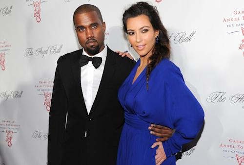 FILE - In this Oct. 22, 2012 file photo, singer Kanye West, left, and girlfriend Kim Kardashian attend Gabrielle's Angel Foundation 2012 Angel Ball cancer research benefit at Cipriani Wall Street in New York. West and Kardashian sued YouTube co-founder Chad Hurley in Los Angeles on Thursday, Oct. 31, 2013, claiming he violated a confidentiality agreement by posting footage of West's elaborate marriage proposal on a new video-sharing site. (Photo by Evan Agostini/Invision/AP, File)