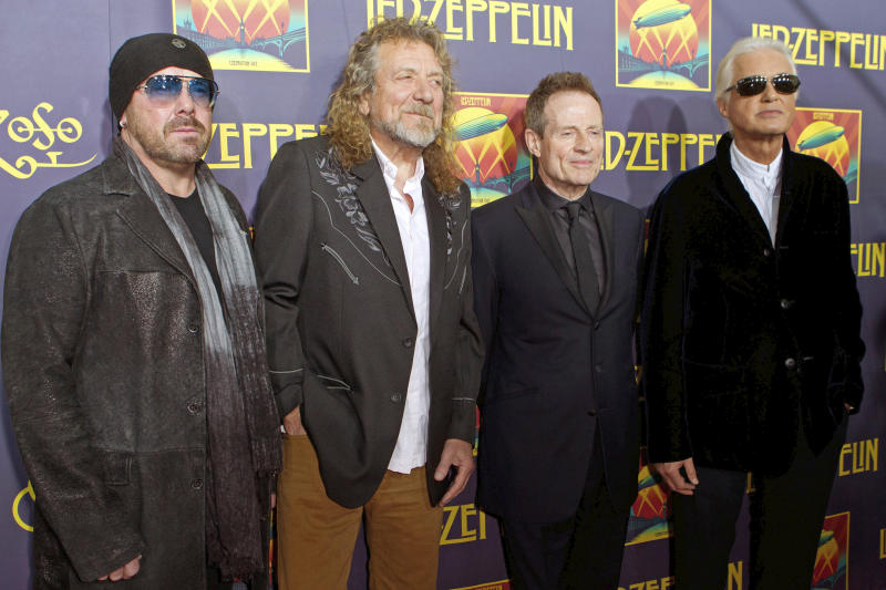 """FILE - This Oct. 9, 2012 file photo shows Led Zeppelin members, from left, Jason Bonham, Robert Plant, John Paul Jones and Jimmy Page at the """"Led Zeppelin: Celebration Day"""" premiere in New York. A federal appeals court on Monday, March 9, 2020, restored a jury verdict that found Led Zeppelin did not steal """"Stairway to Heaven."""" (Photo by Dario Cantatore/Invision/AP, File)"""