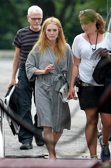 Julianne Moore wears a bathrobe en route to her trailer while filming 'Maps to the Stars' in Toronto