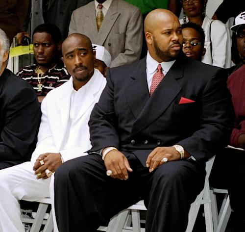 "FILE - In this Aug. 15, 1996, file photo, rapper Tupac Shakur, left, and a founder of Death Row Records, Marion ""Suge"" Knight, attend a voter registration event in South Central Los Angeles. A lawyer for Knight says he was at the wheel of a car involved in an accident in a Los Angeles suburb. It occurred in Compton shortly before 3 p.m. Thursday, Jan. 29, 2015. (AP Photo/Frank Wiese, File)"