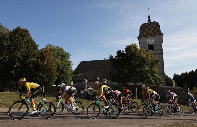 Team Jumbo rider Slovenias Primoz Roglic wearing the overall leaders yellow jersey L and the pack ride during the 19th stage of the 107th edition of the Tour de France cycling race 160 km between BourgenBresse and Champagnole on September 18 2020 Photo by Kenzo Tribouillard AFP Photo by KENZO TRIBOUILLARDAFP via Getty Images