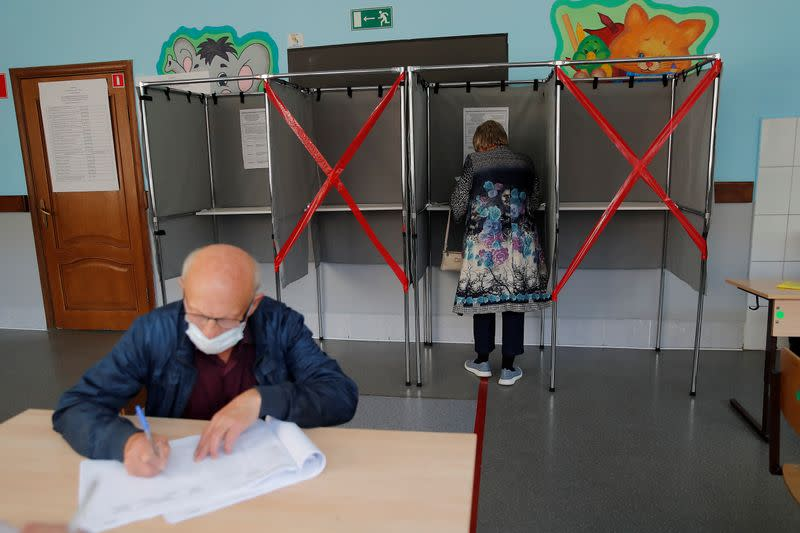 Russia's ruling party loses majority in Siberian council targeted by stricken Navalny