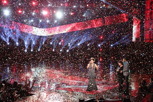 """In this photo provided by NBC, Tessanne Chin performs after being announced the season five winner of """"The Voice"""" on Tuesday, Dec. 17, 2013, in Los Angeles. The 28-year-old Kingston native had nearly given up on her dreams before landing a spot on the NBC singing competition. Chin's coach, Maroon 5 frontman Adam Levine, was also thankful to add a second win to his resume. (AP Photo/NBC, Tyler Golden)"""