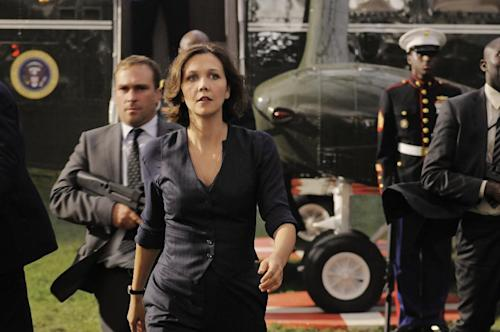 "This film publicity image released by Columbia Pictures shows Maggie Gyllenhaal in a scene from ""White House Down."" (AP Photo/Sony Columbia Pictures, Reiner Bajo)"