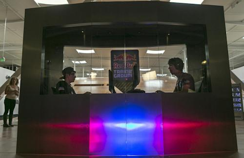 "In this photo taken Friday, June 21, 2013, Bae ""Sound"" Sang Hwan, from South Korea, left, faces legendary ""WarCraft 3"" player, Manuel ""Grubby"" Schenkhuizen, at a player vs. player match inside an ""isolation booth,"" as eight of the world's best ""StarCraft II"" video game players compete at Red Bull Training Grounds, held at Red Bull North America headquarters in Santa Monica, Calif. The Red Bull TV e-sports series includes live-streamed scrimmages and a tournament with $8,600 in prize money. (AP Photo/Damian Dovarganes)"