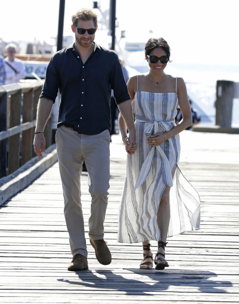 The Duchess of Sussex wearing a Reformation striped dress on Fraser Island in 2018