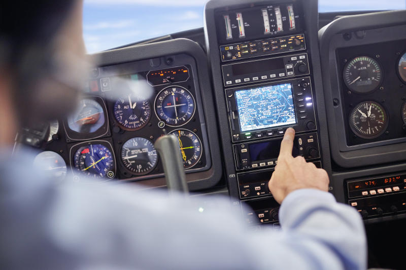 A stock image of a pilot in cockpit.
