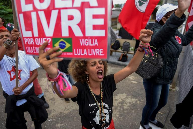 Supporters of former Brazilian President Luiz Inacio Lula da Silva celebrate on November 8, 2019, after a Supreme Court ruling expected to lead to his early release from prison