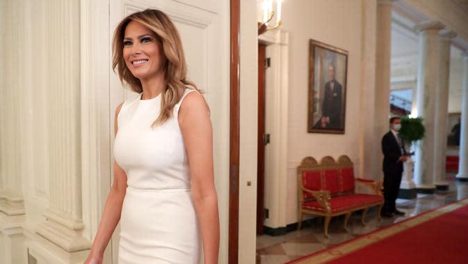 Ibu Negara AS Melania Trump tiba di meja bundar tentang penyakit sel sabit di Ruang Makan Negara Gedung Putih di Washington, DC pada 14 September 2020. AFP/Getty Images/Alex Wong)