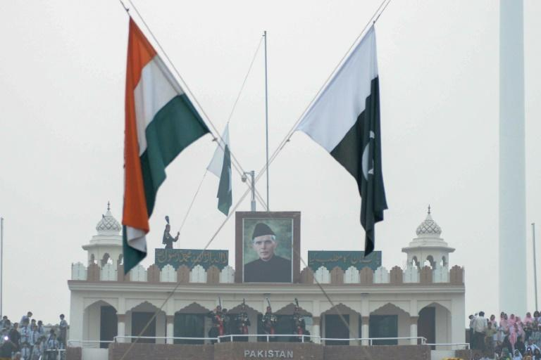 The Indian and Pakistani flags fly during the daily beating of the retreat ceremony at the Wagah Border