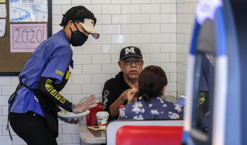 Customers at a Waffle House restaurant in Brookhaven, Ga. on Monday, April 27, 2020. (John Spink/Atlanta Journal-Constitution via AP)
