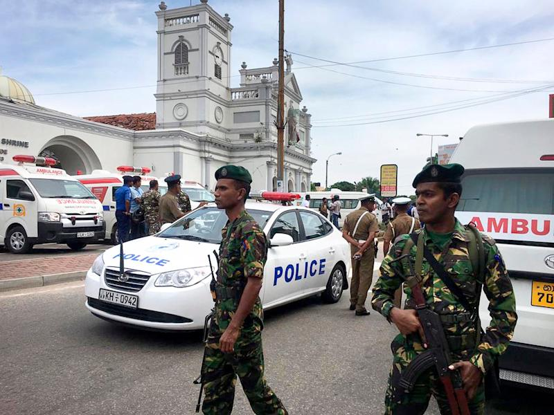 ADDS THE NAME OF CHURCH - Sri Lankan Army soldiers secure the area around St. Anthony's Shrine after a blast in Colombo, Sri Lanka, Sunday, April 21, 2019. Witnesses are reporting two explosions have hit two churches in Sri Lanka on Easter Sunday, causing casualties among worshippers. (AP Photo/Eranga Jayawardena)