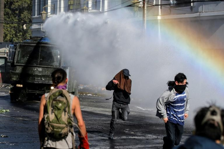 Chile's security forces have used tear gas and water cannons on the most unruly demonstrators