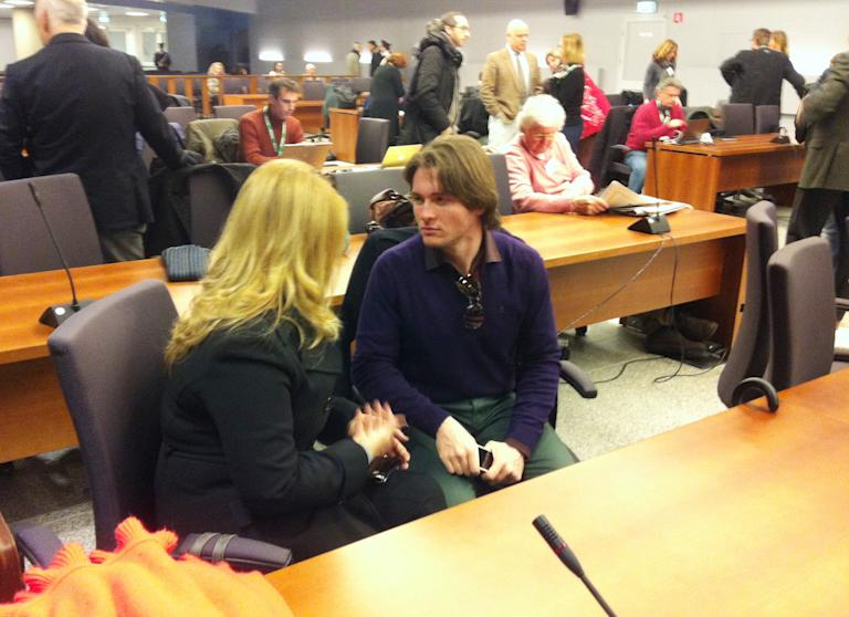Raffaele Sollecito talks with his stepmother Mara Papagni prior to the start of the final hearing before the third court verdict for the murder of British student Meredith Kercher, in Florence, Italy, Thursday, Jan. 30, 2014. The first two trials produced flip-flop verdicts of guilty then innocent for Kercher former roommate, American student Amanda Knox, who is not attending the hearing, and her former Italian boyfriend, Raffaele Sollecito, and the case has produced harshly clashing versions of events. A Florence appeals panel designated by Italy's supreme court to address issues it raised about the acquittal is set to deliberate Thursday, with a verdict expected later in the day. (AP Photo/Fabrizio Giovannozzi)