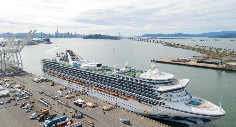 Medical officers tend to passengers disembarking from the Grand Princess cruise ship at the Port of Oakland