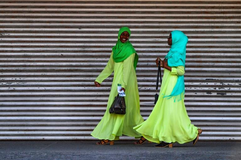 Women laugh as they walk in Georgetown, Guyana, on March 1, 2020
