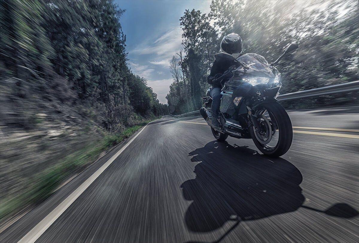 """<p><strong>Types of Motorcycles</strong></p><p><strong></strong><em>Beginner:</em> Look for safety tech (ABS, traction control) and a modest engine size. Between 300 and 400 cc is ideal. Most manufacturers sell an entry-level motorcycle that looks like a race bike, but it will only have a 400-cc single-cylinder engine. These are fast enough to handle highways, yet easier to maintain and less expensive than more complex setups. The major Japanese manufacturers (Honda, Kawasaki, Yamaha) do this type of motorcycle especially well.</p><p><em>Standard/Retro:</em> This is a catch-all category for motorcycles that have a mostly upright riding position and minimal add-ons. Most don't come with windshields or fairings, those aerodynamic pieces of plastic that cover the front portion. The engine is usually a two- or three-cylinder design, between 600 and 900 cc. These are excellent all-around bikes for beginner and intermediate riders who need a compact frame to navigate cities but also want comfort on highways. Non-retro Standard or """"Naked"""" motorcycles usually have the performance of race-looking superbikes, but with a more comfortable seat position and less conspicuous appearance. Triumph's Street Triple, Yamaha's MT-09, and Ducati's Monster are all excellent examples of do-anything motorcycles.</p><p><em>Adventure (ADV):</em> Tall, with big engines and fuel tanks, these are built for long, far rides, mostly on-road—and across gravel, mud, and sand, so long as they have the right tires. Most have engines around 700 cc, though others go up to 1,200 cc. Done right, these are the bikes that should make you want to quit your job and ride around the world. (For asphalt-only riding, Sport Touring motorcycles are closer to the ground, more aerodynamic, and lighter than a typical ADV).</p><p><em>Cruiser:</em> You'll remember seeing these: High handlebars, loud exhaust, slouched riding position, and big engines. The cruiser (or """"bagger,"""" for the saddlebag storage available on most m"""
