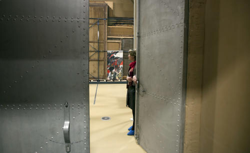 "Press and communications officer Veronique Van Passel opens giant steel doors which lead to an interior warehouse in the Antwerp Royal Museum of Fine Arts in Antwerp, Belgium on Thursday, April 4, 2013. Just as the famous Amsterdam Rijksmuseum in neighbouring Netherlands has returned ""The Night Watch"" of its most famous painter, Rembrandt van Rijn, back in the main building after a ten-year renovation, Antwerp is hiding five oversized Rubens paintings in a special depot to protect them against the rough and tumble of four more years of works. (AP Photo/Virginia Mayo)"