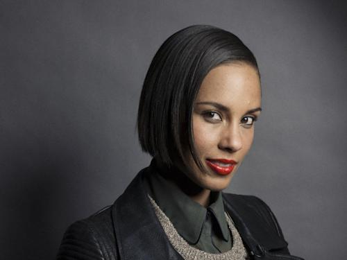 "In this Nov. 26, 2012 photo, musician and actress Alicia Keys poses for a portrait in promotion of her fifth album ""Girl on Fire,"" in New York. Keys cut her hair this summer and is now sporting a bob. And she says she ""actually wants to go even shorter"" in an interview last week. The 31-year-old came on the music scene in 2001 with braids, and has mostly worn her hair long. But she says with her new haircut, she's able to do more with her hair. (Photo by Victoria Will/Invision/AP)"