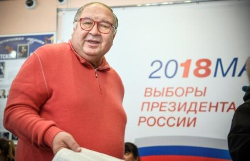Russian businessman Alisher Usmanov casts his ballot at a polling station during Russia's presidential election in Moscow on March 18, 2018