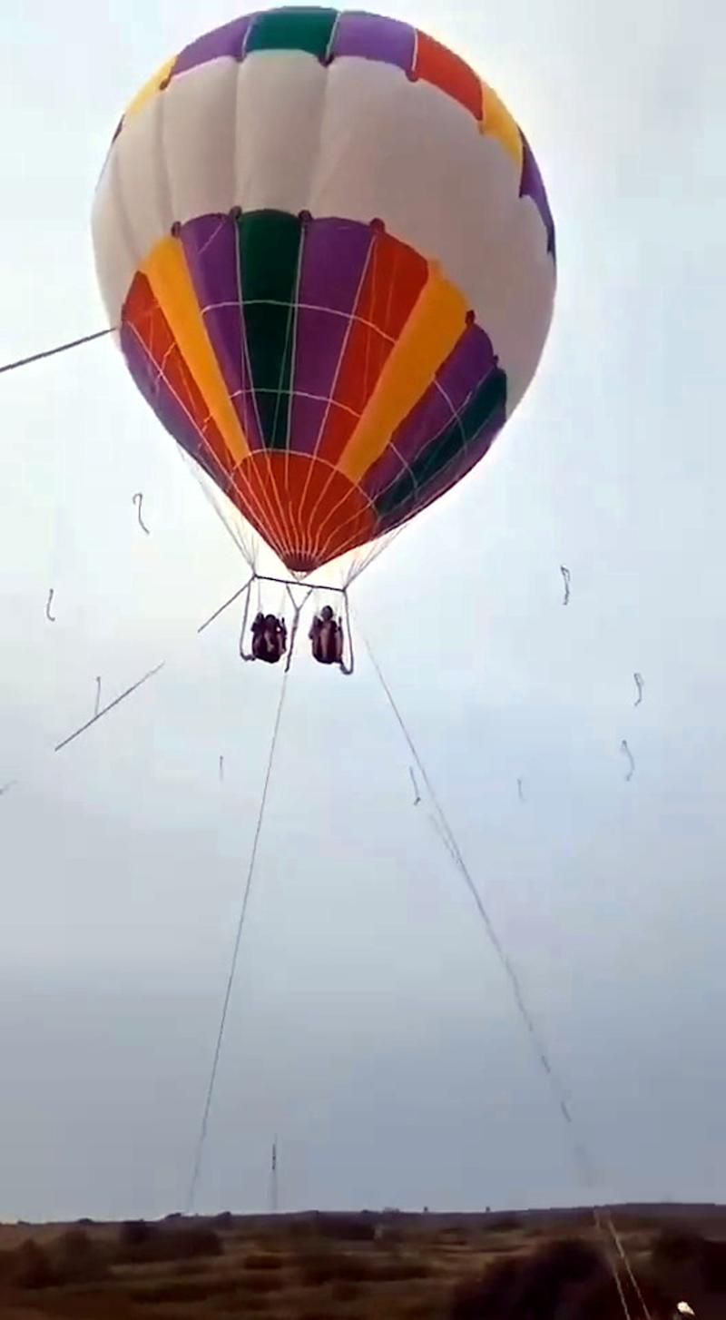 The mum and son floated away after the balloon slipped its moorings. Source: Australscope/AsiaWire