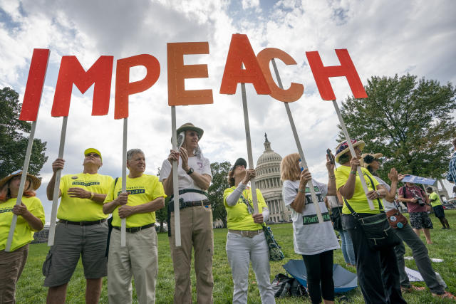Activists rally for the impeachment of President Trump. (Photo: J. Scott Applewhite/AP)