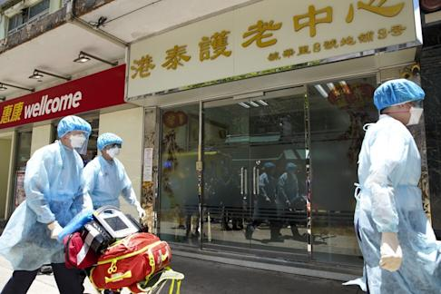 Medical workers at the Kong Tai Care for Aged Centre Limited in Tsz Wan Shan, where an 85-year-old resident has contracted the coronavirus. Photo: Winson Wong