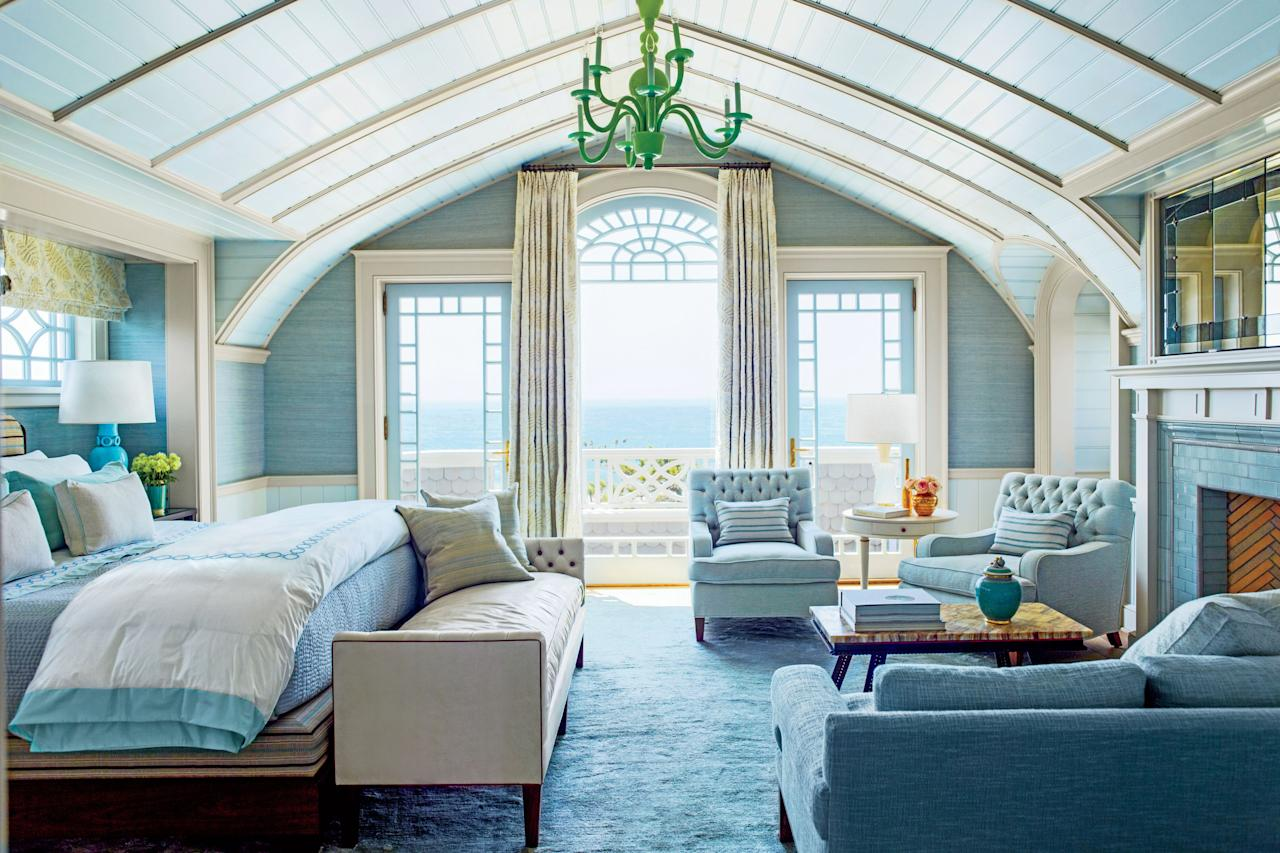 <p>In this Hamptons bedroom, designer Steven Gambrel wrapped the walls in silk that matches the color of the water outside. The fabric's natural striations even mimic the soothing movement of the water, diminishing the divide between beach and bedroom. Talk about a swell scene-stealer!</p>