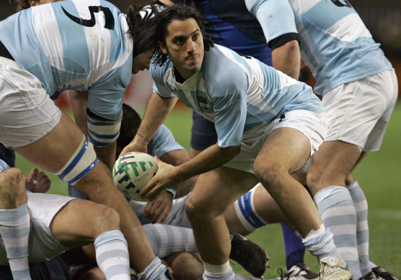 FILE - In this Friday, Oct. 19, 2007 file photo, Argentina's captain Agustin Pichot passes the ball during the Rugby World Cup third place match between France and Argentina, at the Parc des Princes stadium in Paris. Bill Beaumont and Agustin Pichot are vying to become chairman of World Rugby amid trying times for the sport because of the coronavirus outbreak and the growing discussion about a global calendar to unify the international game.  (AP Photo/Christophe Ena, File)