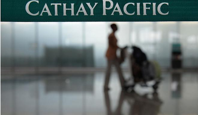 To shore up its customer base with transit passengers Cathay has been cutting fares. Photo: AFP
