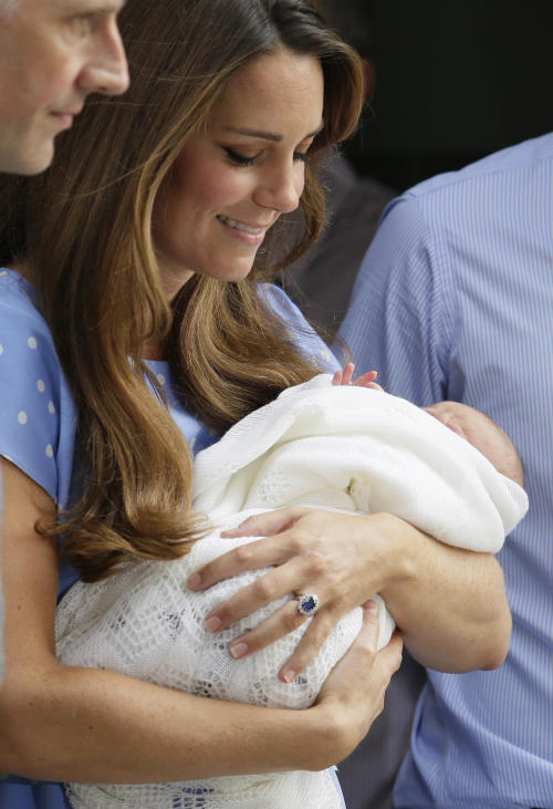 Kate, Duchess of Cambridge holds the Prince of Cambridge, Tuesday July 23, 2013, as they pose for photographers outside St. Mary's Hospital exclusive Lindo Wing in London where the Duchess gave birth on Monday July 22. The Royal couple are expected to head to London's Kensington Palace from the hospital with their newly born son, the third in line to the British throne. (AP Photo/Alastair Grant)